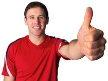 Football fan in red showing thumbs up Stock Image