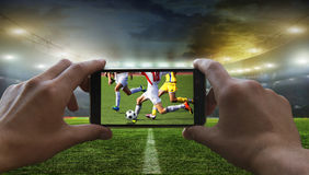 Football fan removes the football game Stock Photography