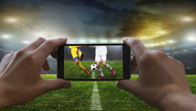Football fan removes the football game Royalty Free Stock Photos