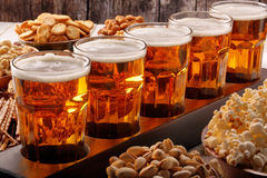Football fan set with beer and snacks on wooden background Stock Images
