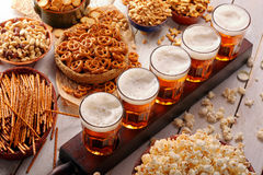 Football fan set with beer and snacks on wooden background Royalty Free Stock Image