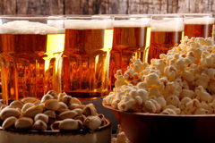 Football fan set with beer and snacks on wooden background Royalty Free Stock Photos