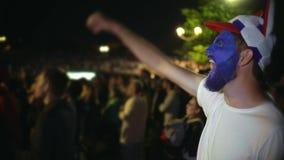 Closeup guy scream furiously, jump friend backdrop crowd from win. Soccer fan. stock video footage