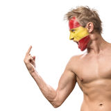Football fan with spain flag painted over face Stock Photos