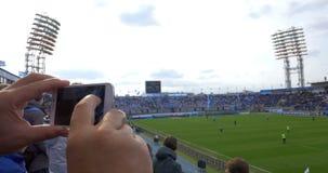 Football Fan Taking Photo of the Field stock video footage