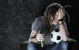 Football fan watching television Stock Photography
