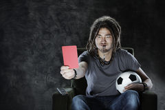 Football fan watching television Stock Photos
