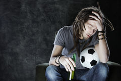 Football fan watching television Royalty Free Stock Photo
