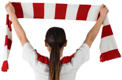 Football fan waving red and white scarf Royalty Free Stock Photography