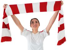 Football fan waving red and white scarf Royalty Free Stock Images