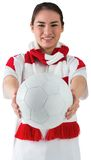 Football fan in white wearing scarf holding ball Royalty Free Stock Photos