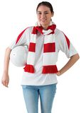 Football fan in white wearing scarf holding ball Stock Image