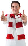 Football fan in white wearing scarf showing thumbs up Stock Photos