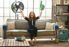 Football fan woman watching tv and rejoicing Stock Photography