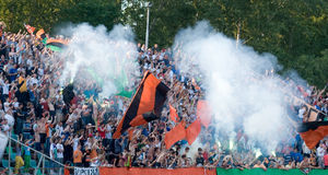 Football fans. Celebrate a victory of the team Ural.The favorite team has won with the account 1:0 at CSKA command. Stadium Uralmash, Yekaterinburg, on July Stock Images