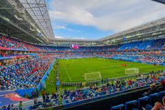 Football fans attend stadion Kaliningrad before match between Serbia and Switzerland. Kaliningrad - Russia, May 22, 2018: Football fans attend stadion royalty free stock image