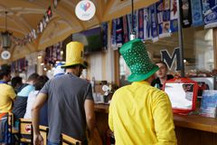 Football fans in the bar in Saint Petersburg during FIFA World Cup Russia 2018. St. Petersburg, Russia - June 23, 2018: Brazilian football fans in the outdoor royalty free stock photo