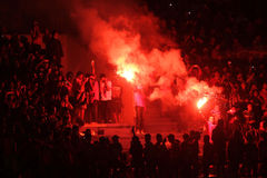 Football fans. Celebrate the victory of his team in the competition between clubs in a stadium in the city of Solo, Central Java, Indonesia stock photos