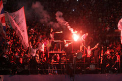 Football fans. Celebrate the victory of his team in the competition between clubs in a stadium in the city of Solo, Central Java, Indonesia Royalty Free Stock Photo