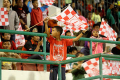 Football fans. Celebrate the victory of his team in the competition between clubs in a stadium in the city of Solo, Central Java, Indonesia Stock Image