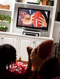 Football: Fans Cheer for Game on Television Stock Image