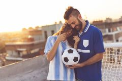 Football fans couple stock photography