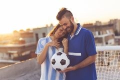 Football fans couple stock images