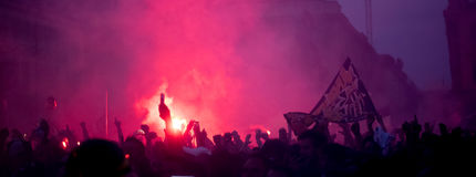 Football fans crowd in the city celebrating victory. In the square Stock Photo
