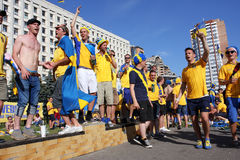 Football fans dance during EURO-2012. Fans of the Swedish national football team have fun during Euro-2012 in Kiev, Ukraine. The Ukrainian host cities are Lviv Royalty Free Stock Image