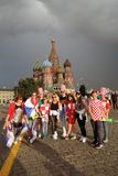 Football fans pose for photos on the Red Square in Moscow