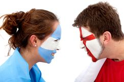 Football fans duel Royalty Free Stock Photo