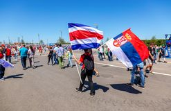 Football fans with flags of Costa Rica and Serbia Royalty Free Stock Images
