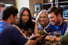 Football fans or friends with beer at sport bar Royalty Free Stock Image