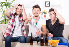Football fans. Group of sports fans watching game on TV at home Royalty Free Stock Photography