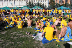 Football fans have rest and drink beer outdoor  Royalty Free Stock Images