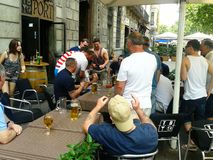 football fans having fun on the terrace of a pub in the Barcelona stock photography