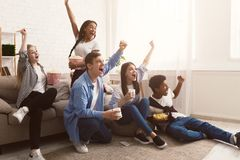 Football fans. Jouful friends screaming, watching match together. Having day-off royalty free stock image