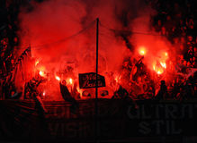 Football fans light flares Stock Image