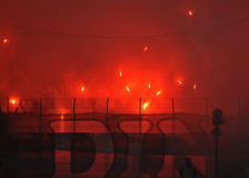 Football fans light flares Royalty Free Stock Photo