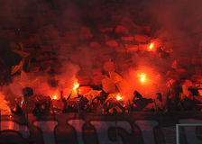 Football fans light flares Royalty Free Stock Photography