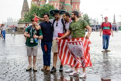 Football fans are photographed on Red Square in Moscow royalty free stock image