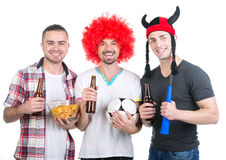 Football fans. Portrait of three football fans with soccer ball, vuvuzela get ready for game viewing Stock Images