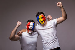 Football fans of Romania and France national teams celebrate, dance and scream. France vs Romania. Football fans of Romania and France national teams celebrate Royalty Free Stock Image