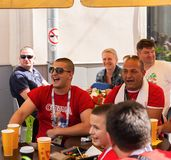 Football fans from Serbia in the bar on Nikolskaya street in c. MOSCOW, RUSSIA - June 27, 2018: Football fans from Serbia in the bar on Nikolskaya street stock image