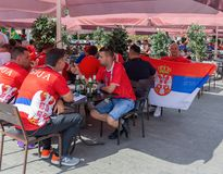 Football fans from Serbia in the bar street in center Moscow. MOSCOW, RUSSIA - June 27, 2018: Football fans from Serbia in the bar street stock photography