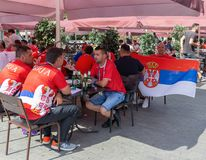 Football fans from Serbia in the bar street in center Moscow. MOSCOW, RUSSIA - June 27, 2018: Football fans from Serbia in the bar street royalty free stock images