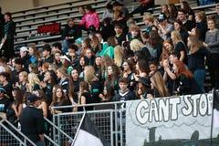 High School Football Fans. Football fans sit in the stands during a high school football game stock image