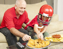 Football Fans and Snacks Stock Images