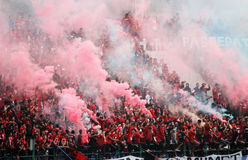 Football fans. Supporters of the football club to celebrate the victory of his team in a stadium in the city of Solo, Central Java, Indonesia Stock Photo