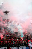 Football fans. Supporters of the football club to celebrate the victory of his team in a stadium in the city of Solo, Central Java, Indonesia Royalty Free Stock Image